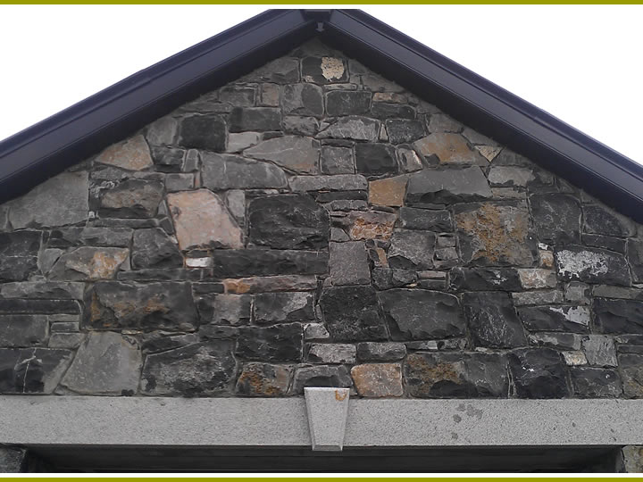 Stone.Garage.With.Cutstone.Archway.Cladding.4