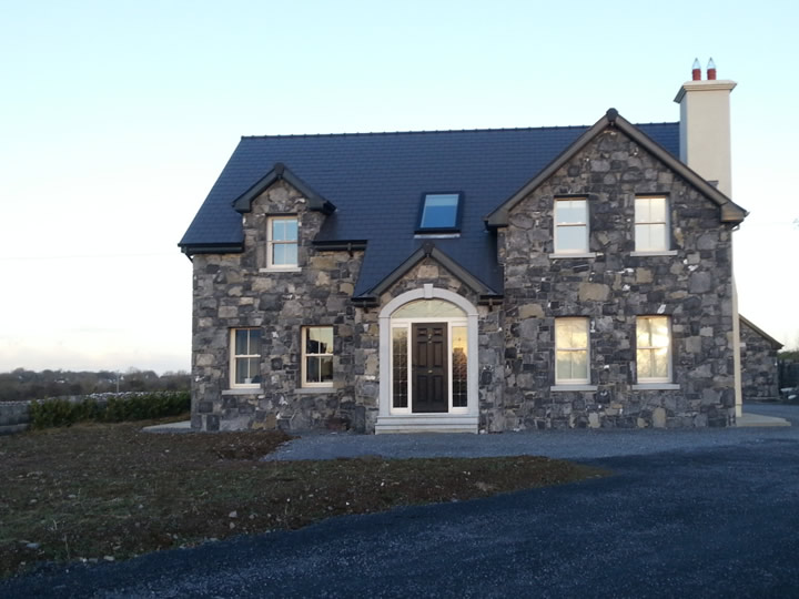 Stone.House.With.Door.Archway.Cladding