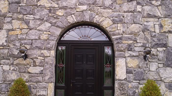 Limestone house - Archway windows and doors