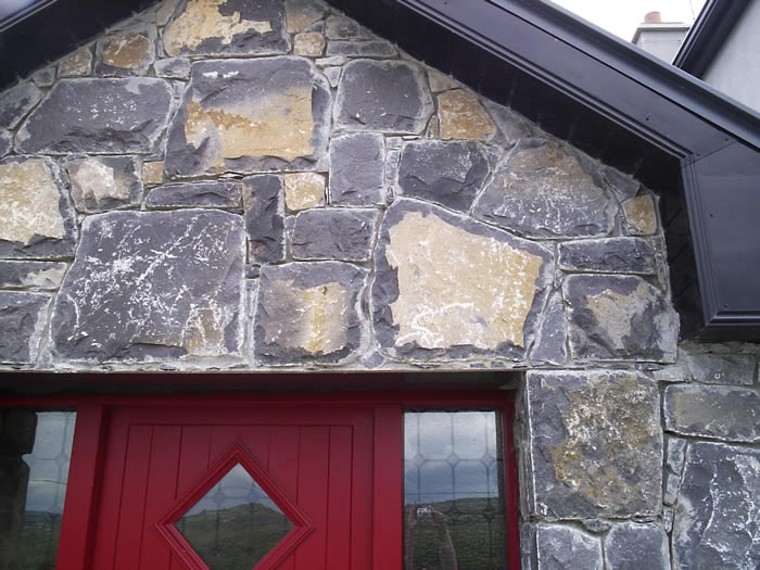 Limestone.Cladding.House.Red.Windows3.700.by.525