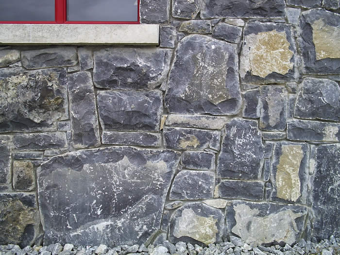 Limestone.Cladding.House.Red.Windows5.700.by.525