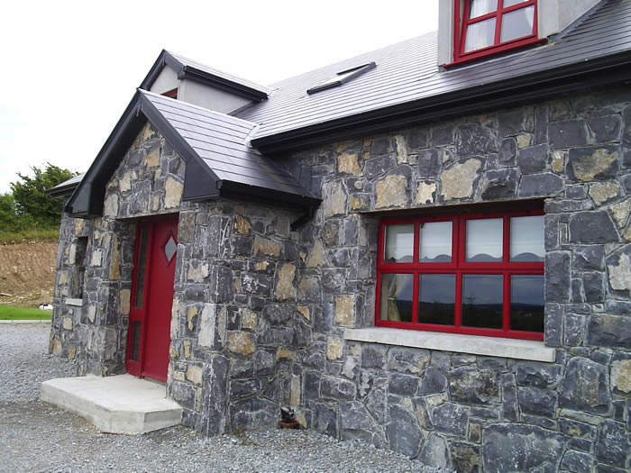Limestone.Cladding.House.Red.Windows8.700.by.525
